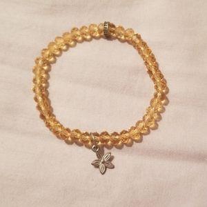 Amber bracelet with star flower charm
